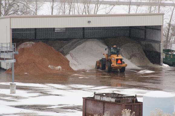 3 sided shed with stockpiles of deicing materials