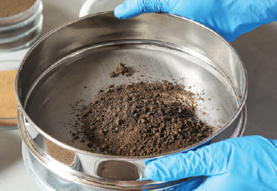 Soil particles in an industrial sieve